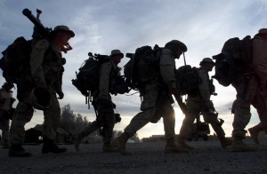 FILE - In this Monday, Dec. 31, 2001 file picture, Marines with full battle gear prepare to board transport helicopters at the U.S. military compound at Kandahar airport for a mission to an undisclosed location in Afghanistan. (AP Photo/John Moore, File) PHOTO PACKAGE FOR USE WITH AFGHANISTAN ANNIVERSARY STORIES